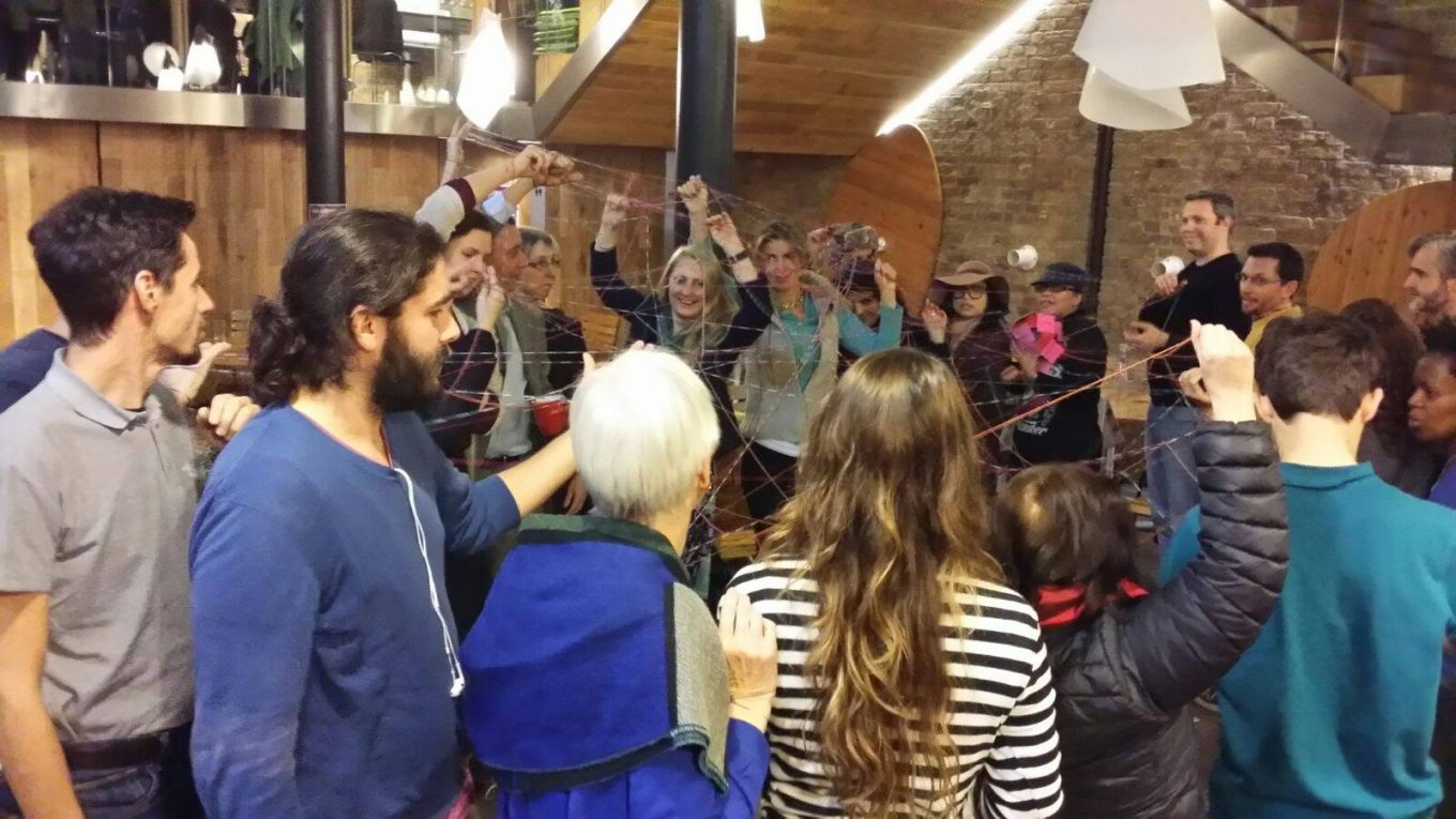 U.lab group at Impact Hub Kings Cross (2016), in a heart warming exercise, weaving the interconnection.