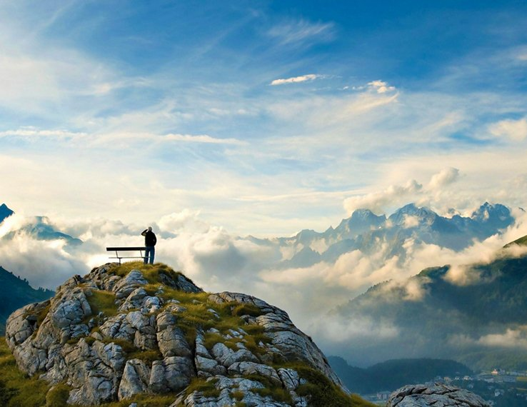Man on top of a mountain. http://www.sampaikini.com/