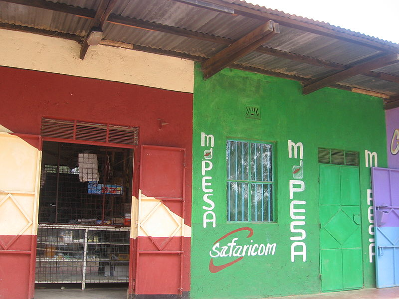 A kiosk displays M-pesa advertising in Kenya in 2012 - Solving the Dilemma of Financial Exclusion with Blockchain and Technology